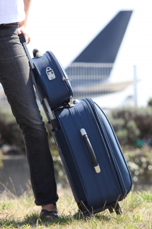 13976802 - woman with a suitcase at an airport